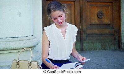 Higher education dreaming girl freshwoman student sitting on...