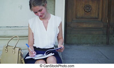 Higher education happy girl freshwoman student sitting on...
