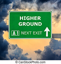 HIGHER GROUND road sign against clear blue sky