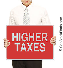 A man holding a sign indicating higher taxes