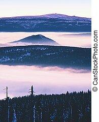 Highest hills above inverse mist. Winter cold weather in...