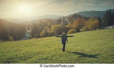 Highland mountain sight happy girl run aerial view - Autumn...