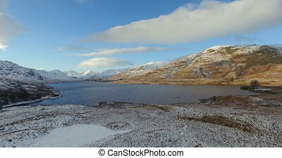 Highlands during winter, Scotland - Aerial: Stunning view of...