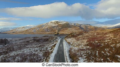 Highlands in winter, Scotland - Aerial: Stunning view of...