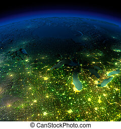 Highly detailed Earth, illuminated by moonlight. The glow of...