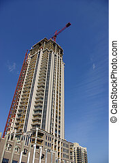 Highrise Condo Constructi - A tall residential condominium...