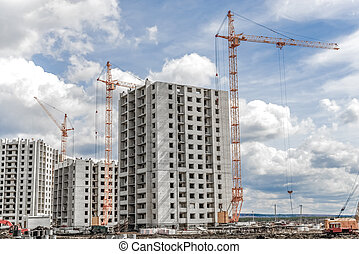 New residential development and industrial construction cranes