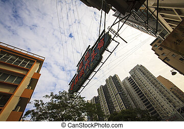 HONG KONG - JANUARY 8 : Hong Kong's High rise buildings in the central of Kowloon district on 8 January 2013 in Hong Kong. Hong Kong is one of the metropolitan with the high density of population of the world.