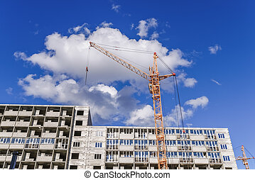 Highrise houses and crane