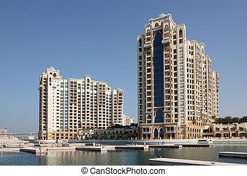 Highrise residential buildings on Palm Jumeirah, Dubai,...