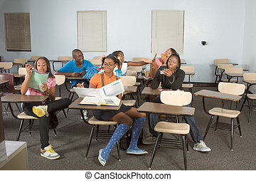 Highschool students messing in class during break