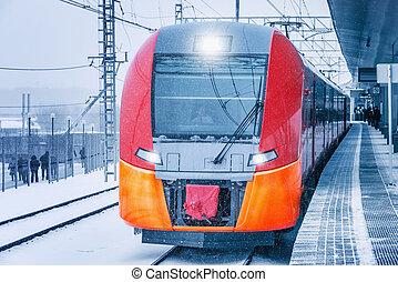 Highspeed train stands by the platform. - Highspeed train...