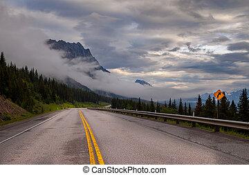 Highway 40 in Kananaskis Country, Alberta, Canada on a gloomy rainy day