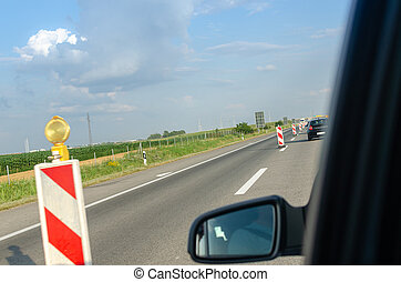 Highway and a wing mirror