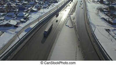 Highway and cars in winter Aerial video