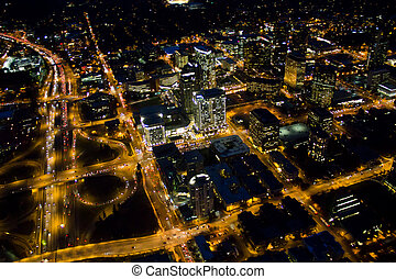 Highway and City at Night - Aerial view of nighttime ...