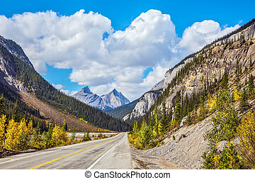 Highway and magnificent mountains