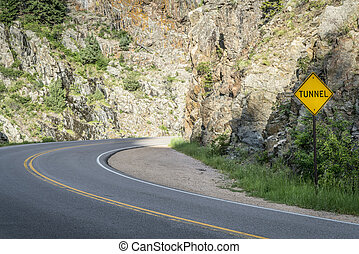 Colorado highway 14 approaching a tunnel in the Poudre Canyon near Fort Collins