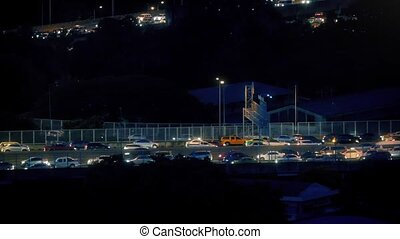 Highway At Night Lit Up With Cars - Pretty night scene of...