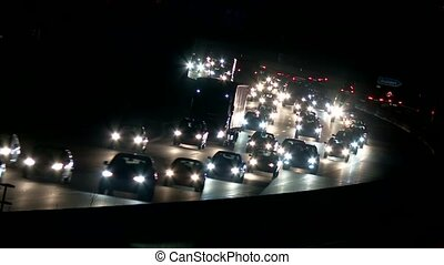 Highway at night with traffic - video footage of traffic on...