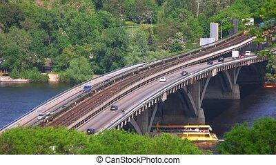 Highway bridge and car traffic. Ship under bridge. Warm...