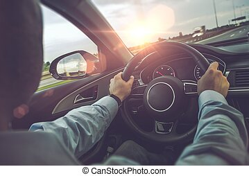 Highway Car Driving. Caucasian Men Behind the Wheel on His...