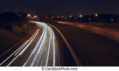Highway corner. Timelapse at night.