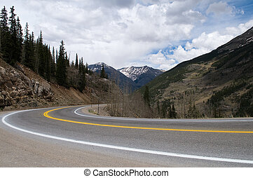 Highway curve - A curve in a highway through the mountains,...