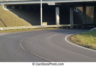Highway curve under a viaduct.