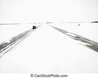 Highway in a winter storm. - Transfer truck driving down...