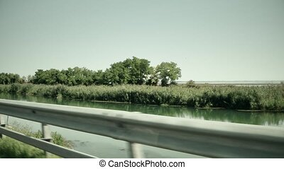 Highway in European wetlands. View from the moving car -...