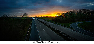 highway in the evening with sunset