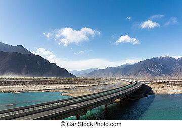 highway in tibet - highway across the brahmaputra valley in...