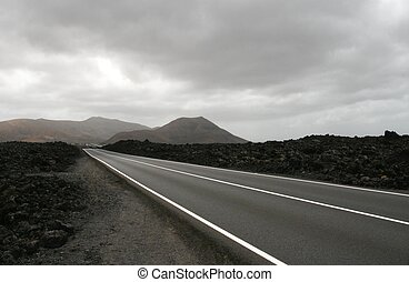 Highway in volcano landscape on Lanzarote