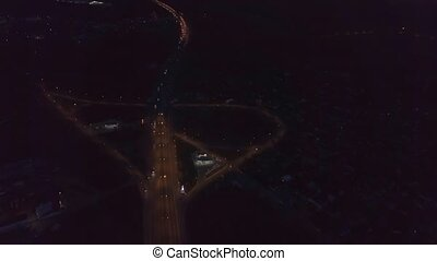 Highway interchange aerial - Aerial view highway night...