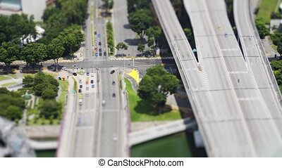 Vehicles look like toys on a complex highway interchange in urban singapore, from an elevated perspective and in selective focus. Video 4k UltraHD