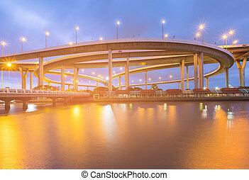 Highway interchange river front night light