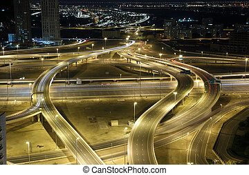 Highway intersection at night. Dubai, UAE