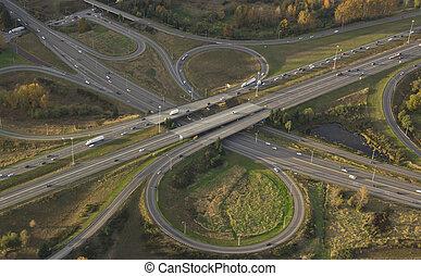 Aerial view of rush hour traffic crossing interstate bridge