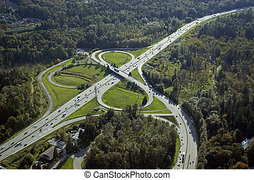 Highway intersection - Cars and trucks on the highway...