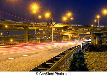 Highway Junction - Cars, racing past a huge highway junction...