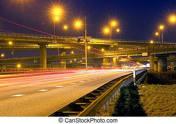 Highway Junction - Cars, racing past a huge highway junction...
