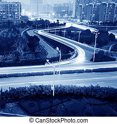 Highway light trails - beautiful light trail at the busy...