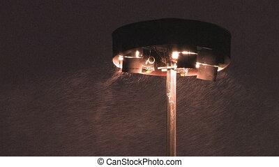Highway lights in snowstorm.