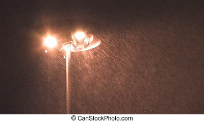 Highway lights in snowstorm. - Heavy snow illuminated by...