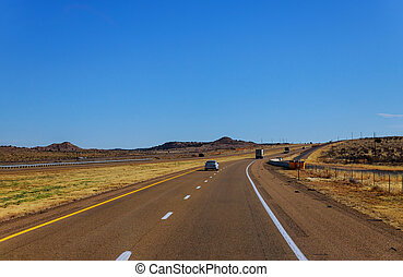 Highway lone road through the scenic view in New Mexico - ...