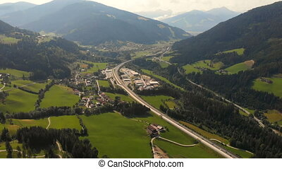 Highway mountains road aerial country village forest -...