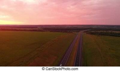 Highway on a sunset background. Travel by car along the...