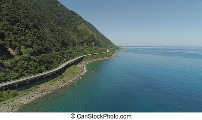 Highway on the viaduct by the sea. Philippines, Luzon -...