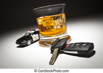 Highway Patrol Police Car Next to Alcoholic Drink and Keys